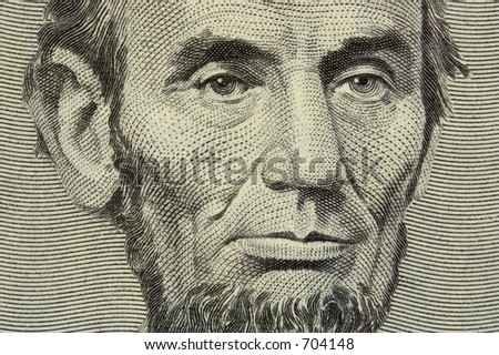 president Lincoln face on the five dollar bill - stock photo