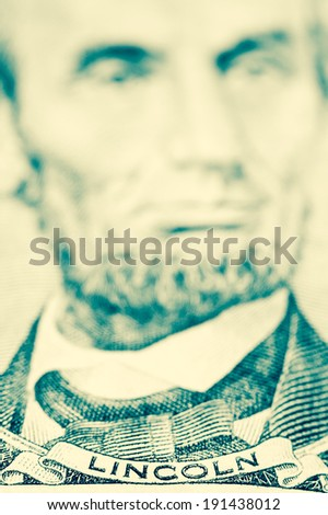 President Lincoln on a five dollar bill. - stock photo