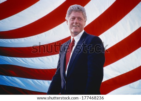 President William Jefferson Clinton in front of American flag stripes - stock photo