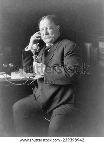 President William Taft (1857-1930) using the telephone during 1908, the year of his election to the US presidency.