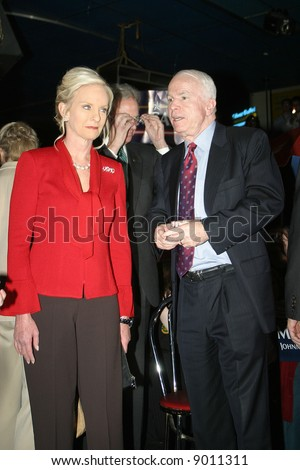 Presidential candidate John McCain and wife Cindy McCain at pre-debate rally in Myrtle Beach, SC January 10, 2008 - stock photo