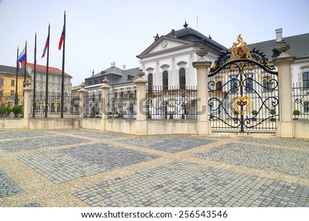 Presidential Palace (Grassalkovich Palace) surrounded by cast iron fence with highly decorated gate, Bratislava, Slovakia - stock photo