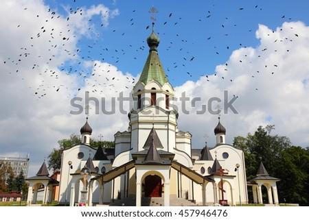 Presov, Slovakia - Orthodox Cathedral of St Prince Alexander Nevsky. Ominous black birds. - stock photo