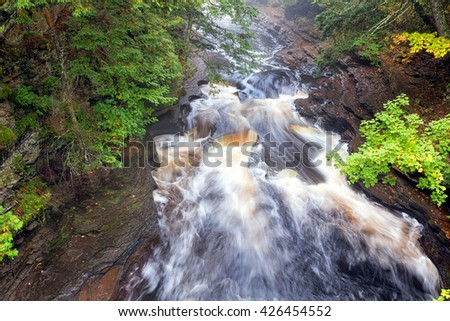 Presque Isle River Pot Holes. Water flows over pot holes in the Presque Isle River in the Upper Peninsula of Michigan - stock photo