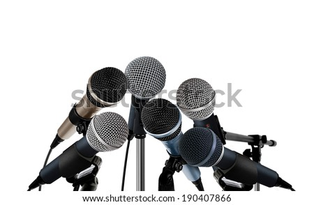 Press Conference Microphones on White - stock photo