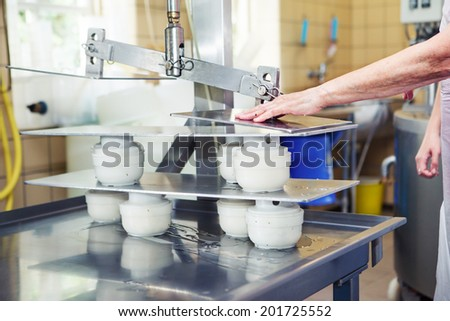 Press equipment at the artisan cheese manufacture - stock photo
