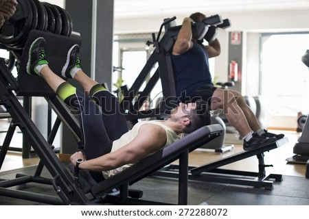 Press exercises at gym, two real men training