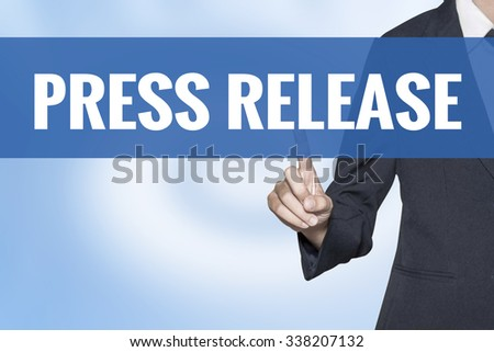 Press Release word on virtual screen touch by business woman blue background - stock photo