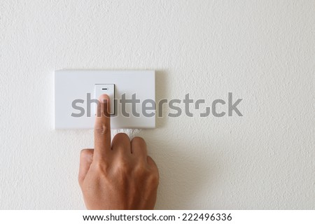 Press turn on/off electrical switch - stock photo
