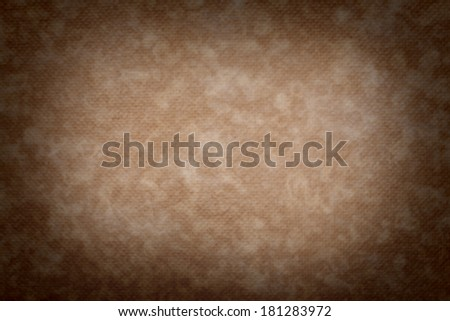 Pressed brown old worn synthetic packing paper background that was became weary highlighted by sun or day light in center - stock photo