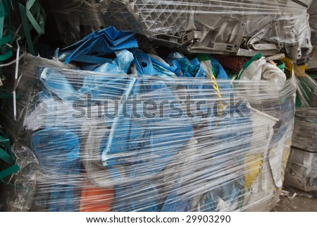 pressed pack of plastic garbage for reuse - stock photo