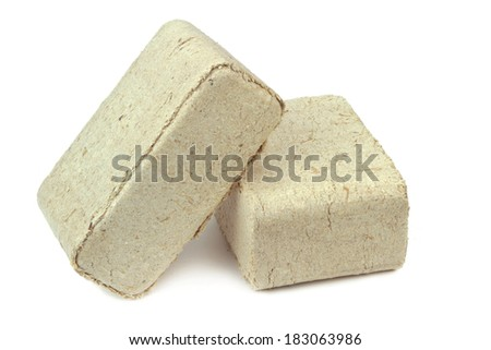 Pressed sawdust, wood briquettes isolated on white background.