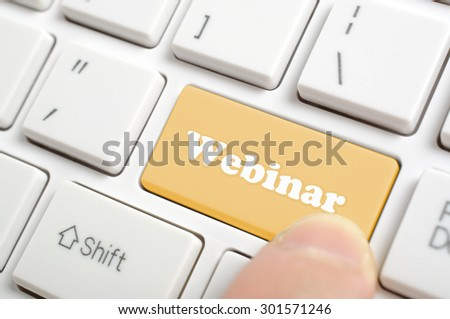 Pressing brown webinar key on keyboard - stock photo