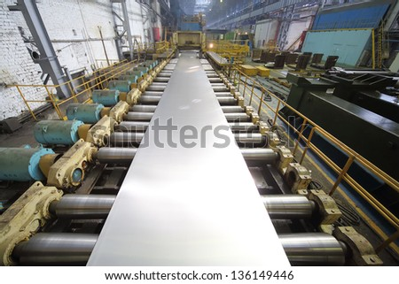 Pressing machine of rolling mill from a block of aluminum makes a sheet - stock photo