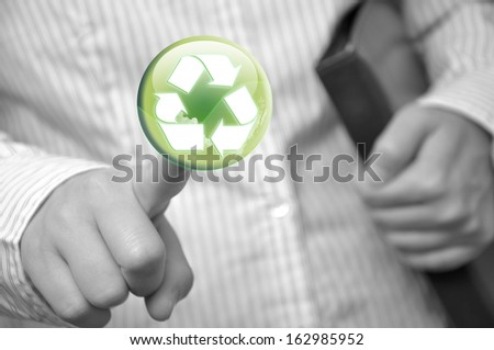Pressing recycle sign button - stock photo
