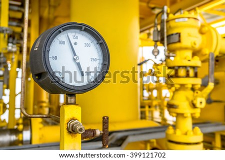 Pressure gauge for monitoring measure pressure in oil and gas process, Oil and gas offshore wellhead remote platform in the gulf or the sea, Energy and petroleum industry. - stock photo
