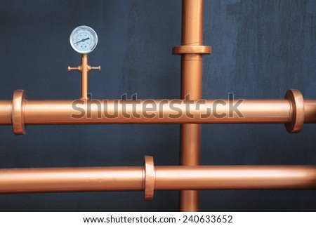 Pressure gauge meter installed on copper pipes - stock photo