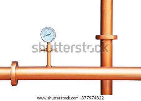 Pressure gauge meter installed on copper pipes isolated on white background