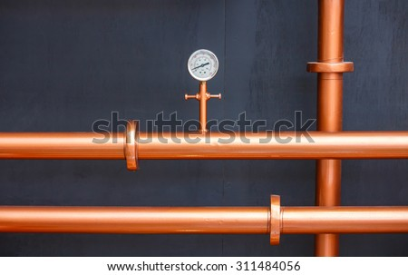 Pressure gauge meter on copper pipes - stock photo