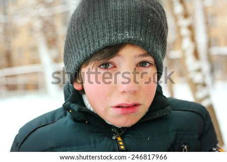 preteen boy cry frustrated after tearing his jacket - stock photo