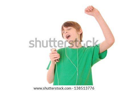 Preteen Boy Singing Along to Music on mp3 Player - stock photo