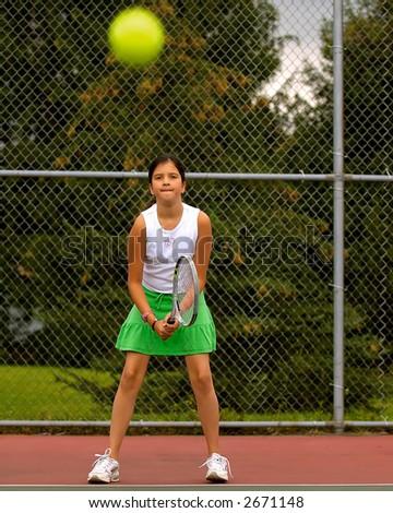 Preteen girl playing tennis. - stock photo