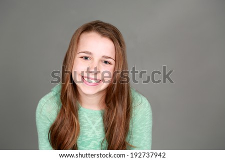 preteen girl smiling and looking at camera