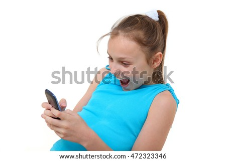 preteen girl using mobile phone