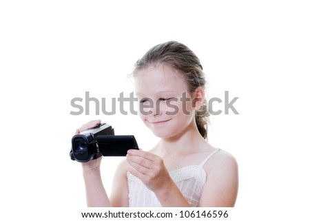 preteen girl with video camera - stock photo