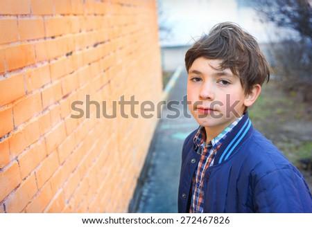 preteen handsome boy close up outdoor portrait - stock photo