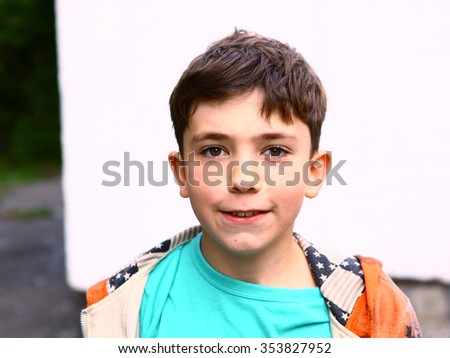 preteen handsome boy outdoor portrait on the white wall background - stock photo