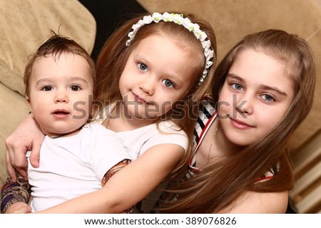 preteen siblings two sisters and brother close up portrait