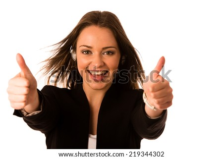 Pretety happy asian caucasian business woman with headset showing thumb up as a gesture for success isolated - stock photo