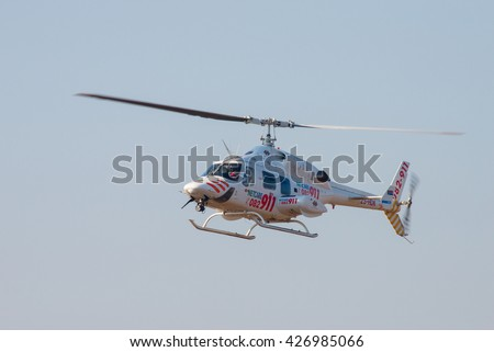 PRETORIA, SOUTH AFRICA-MAY 7 2016: A Bell 222 UT Netcare 911 air ambulance flys past at the Swartkops Museum Airshow