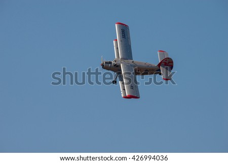 PRETORIA, SOUTH AFRICA-MAY 7 2016: Little Annie an Antonov An-2  doing a slow banking turn at the Swartkops Museum Airshow