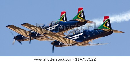PRETORIA, SOUTH AFRICA -SEPT. 23:  The Silver Falcons aerobatic team at the African Aerospace & Defence show on Sept. 23, 2012 at AFB Waterkloof in Pretoria. - stock photo