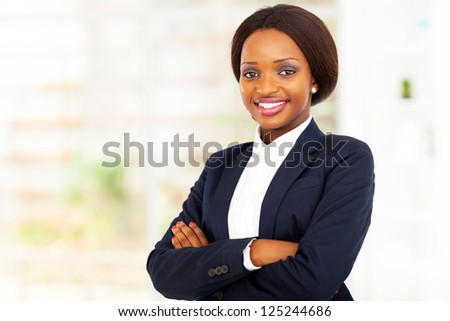 pretty african american businesswoman half length portrait in office - stock photo