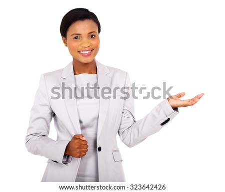 pretty african american businesswoman presenting on white background - stock photo