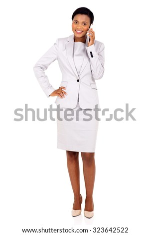 pretty african american businesswoman talking on mobile phone isolated on white - stock photo