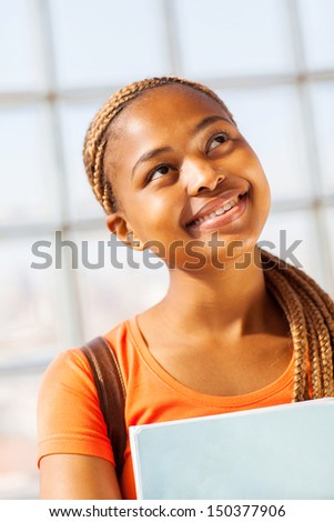 pretty african american college girl looking up - stock photo