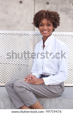 pretty African American executive sitting outside