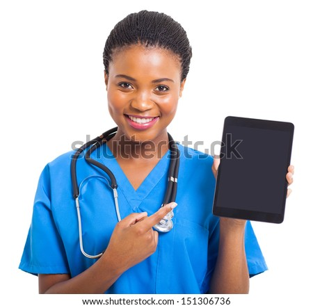 pretty african american nurse pointing tablet computer on white background - stock photo