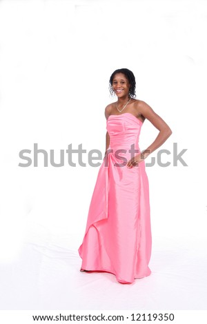 Pretty African American teenage girl in a strapless pink gown. - stock photo