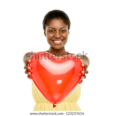 Pretty African American woman holding Red Heart Balloon isolated on white background - stock photo