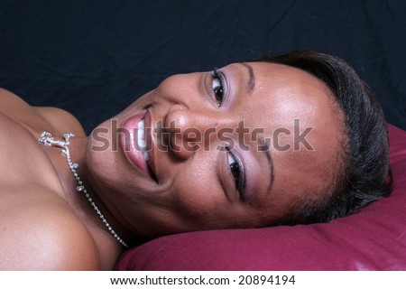 pretty african american woman laying down - stock photo