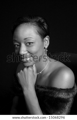 Pretty African American woman looking at the camera smiling - stock photo