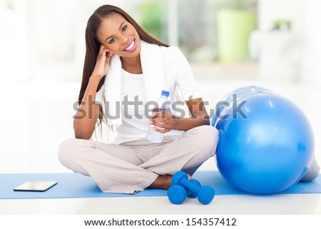 pretty african american woman resting at gym - stock photo
