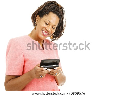 Pretty african-american woman sending a text message on her smart phone.  Isolated on white. - stock photo
