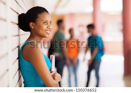 pretty african college student looking away - stock photo
