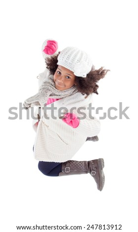Pretty african girl jumping with winter clothes isolated on a white background - stock photo